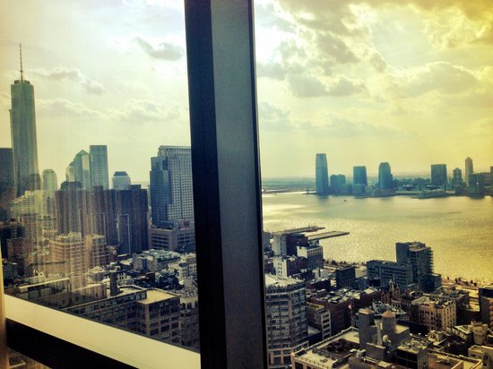 The Dominick Hotel: One bedroom executive suite living room view of one world trade day time floor 41