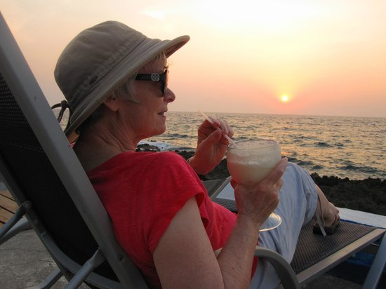 Lands End: Relaxing just outside our room with a piña colada at sunset