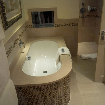 Pennyhill Park, an Exclusive Hotel & Spa: Our bathroom with tv...