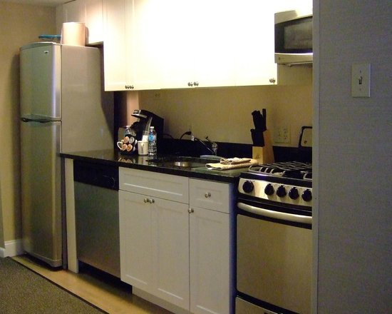 The Windsor Suites: Kitchen with full fridge, 4-burner range, pots, pans, steak knives and more!