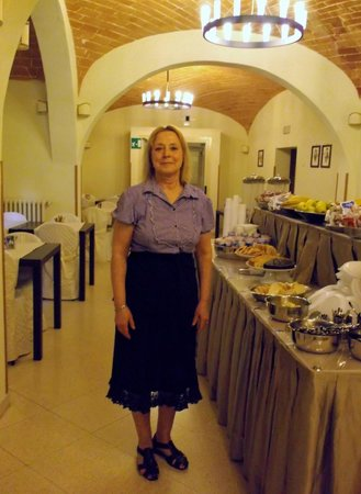 Hotel Alma Domus: A Better Photo of Alexandra and Her Breakfasts - T.A. hasn't taken the other one down.