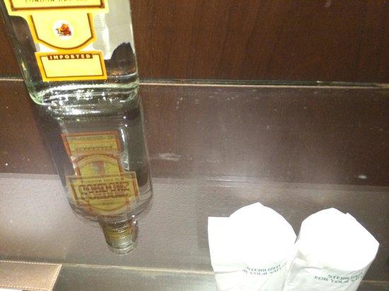 Peace Laguna Resort and Spa: dusty mini bar shelf