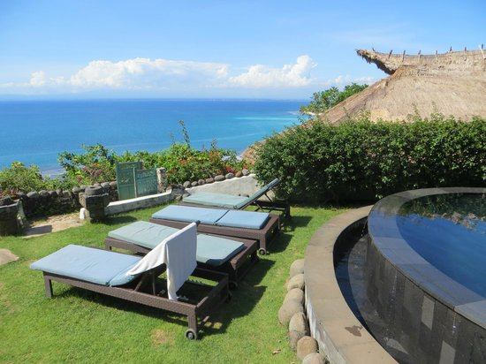 The Temple Lodge: Sun beds, the pool, and the view