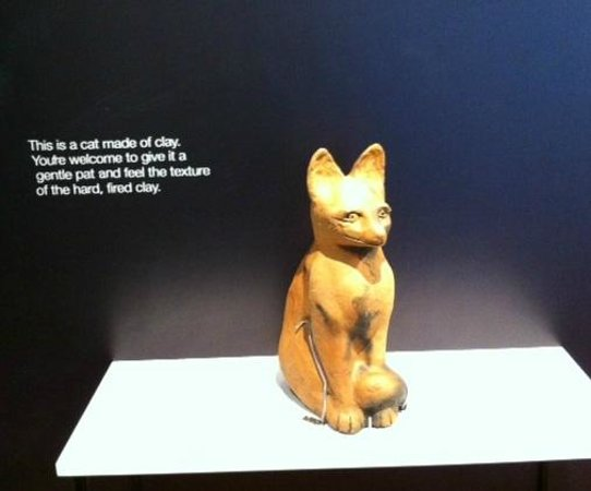 MTG Hawke's Bay : Touchable ceramic cat at the entrance to Bronwynne Cornish's exhibition