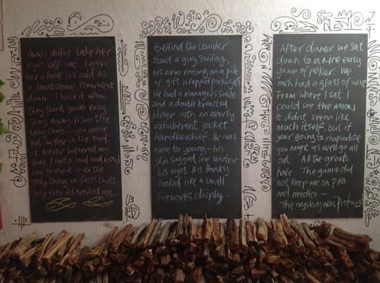 Noisy Oyster: Chalkboard with beautiful words, inside restaurant