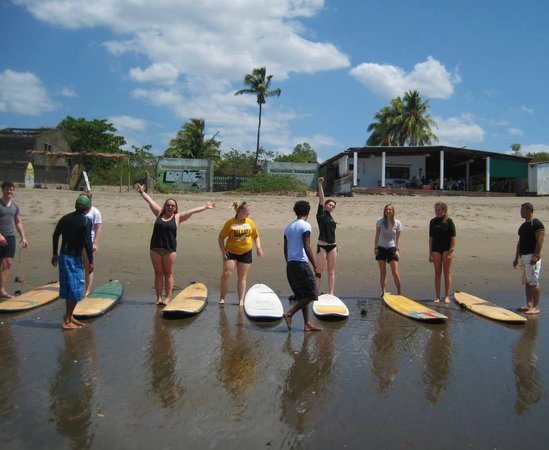 Latina Hostal: on the ground lessons before getting to the water, at Latina Surf Ranch