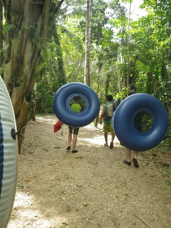 Cave Tubing R Us: Our group making the walk