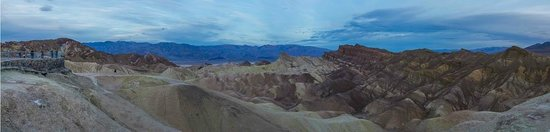 Zabriskie Point: Predawn Panorama from Ridge by path.  Note Plaza on left (new fence) & rude photographer