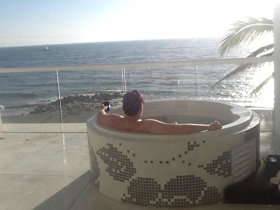 Hilton Puerto Vallarta Resort : Husband in jetted tub on private oceanfront balcony room 303.
