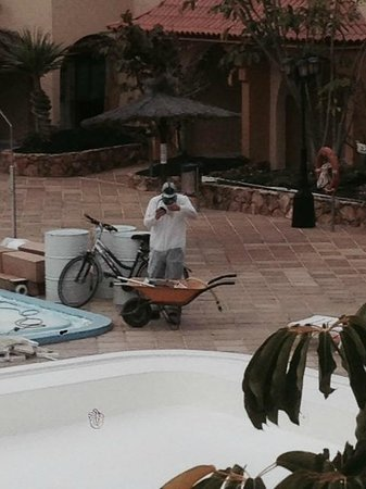 Elba Lucia Sport & Suite Hotel: workman masking up wheres ours!!!!