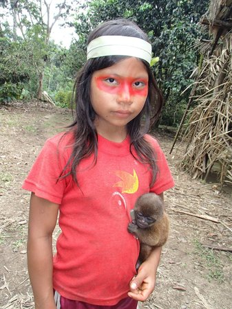 Huaorani Ecolodge: a Wao girl with her pet, a baby wooly monkey