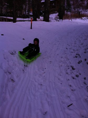 Mountain Air Cabins : sledding outside our cabin