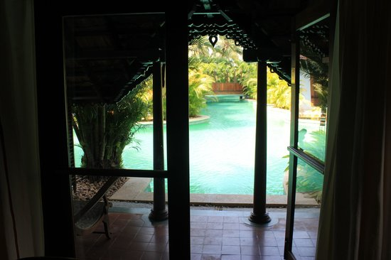 Kumarakom Lake Resort: Villa opening to the pool.