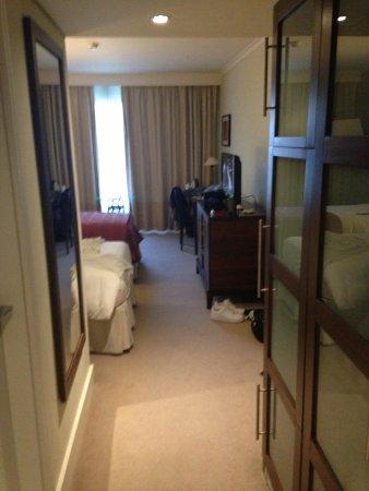 Corinthia Hotel Lisbon: As soon as you enter the room, wardrobe on right & toilet on left