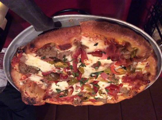 Ciao Wood Fired Pizza and Trattoria: A house special..Italian sausage, roasted onions, ricotta, hot cherry peppers
