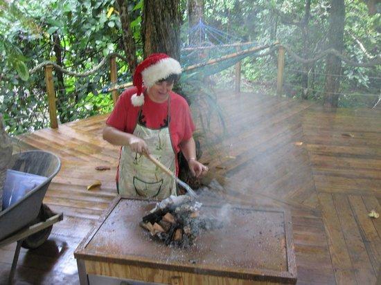 Mermaid's Secret - Riverside Retreat: Sam preparing for the roast