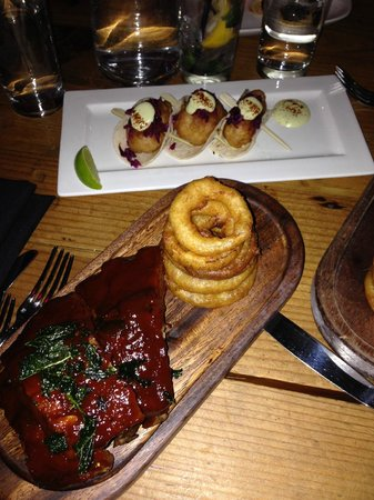 Beauty & Essex : BBQ spare ribs and lobster tacos in background