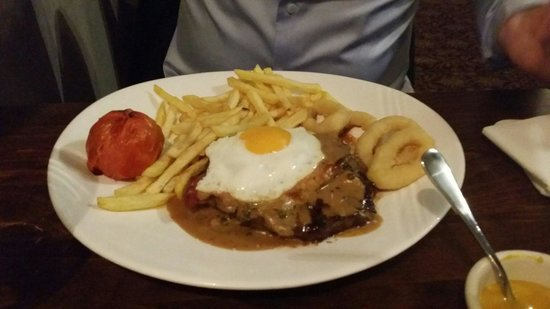The White Hart Hotel: 8 ounce rump steak,  bacon and egg.  Great except the onion rings could of done with crisping up