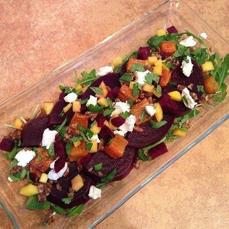 Cha Cha's Kitchen: Roasted carrot, beet, pecan, goat cheese, mango, arugala salad, with lime/cumin vinaigrette
