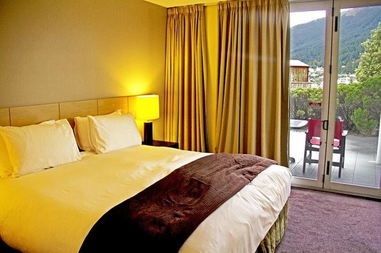 Scenic Suites Queenstown: Bedroom opens onto patio, partial views but also traffic noise