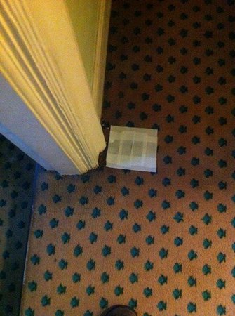 The Old Ship Hotel : Gaffer tape over hole in carpet
