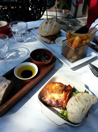 Sabroso tapas and grill: Eggplant lasagne.  Warm tossed olives with dipping bread and chorizo burger with potato wedges.