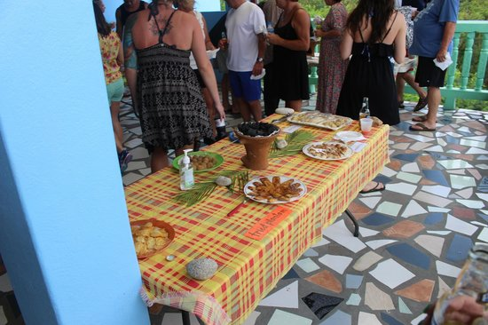 Cosol Tours: Multiple tables of food prepared by one sweet local lady.