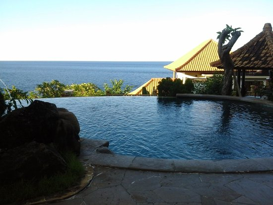 Blue Moon Villas: View of pool and ocean