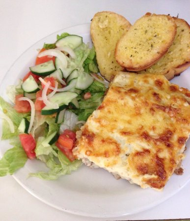 Marco Polo Bar & Grill : Homemade Lasagne & Garlic Bread as a lunch time special $20 bds