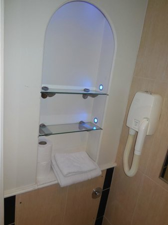 Rhodes Hotel : Ledges in the bathroom with fancy lighting. On the small side but sufficient and very clean.