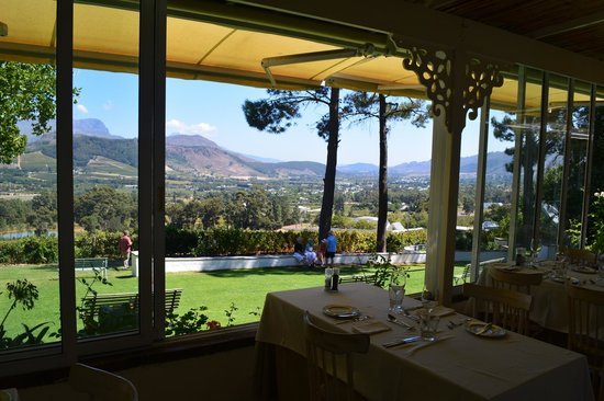 La Petite Ferme: view from the verandah where there is outdoor seating