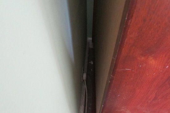 Redcar Hotel: dust and tissue behind wardrobe