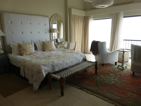 On the Beach Guesthouse: king sized bed with a view