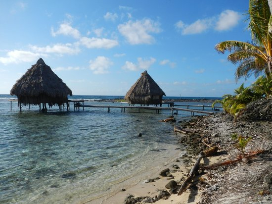 Glover's Atoll Resort: view from shore to the cabanas