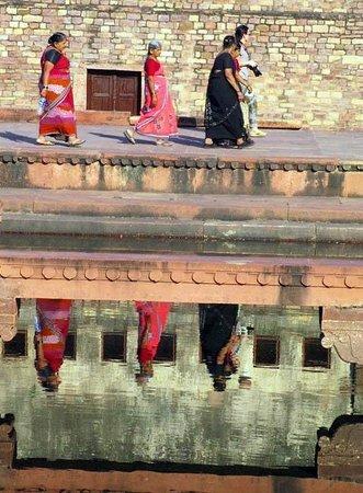 Visitors reflected in pool at Fatehpur Sikri