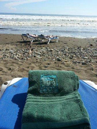 "Domincal beach, rocky and ""muddy"" sand; but fun barter mart"