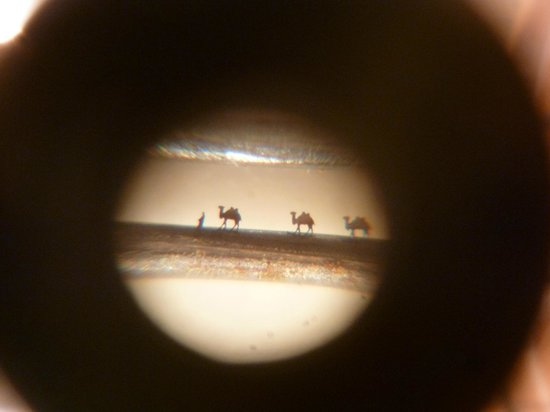 Museum of Miniatures: Camel caravan in eye of a needle