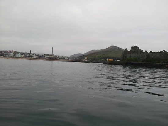 Peel Marina: Marina entrance and Peel Castle from external harbour wall