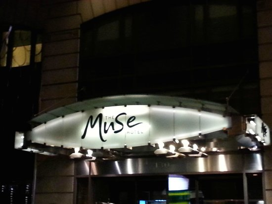 The Muse Hotel New York: Entrance to the Hotel at night.