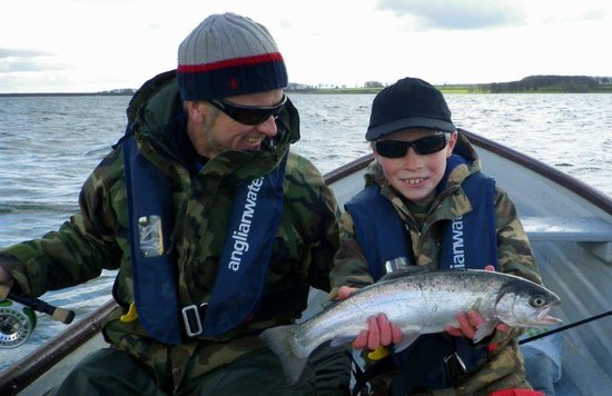 Rutland Water Fly Fishing - Day Trips: Proud son with his first Rainbow Trout