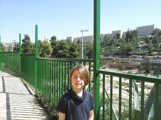Avissar House: my son outside avissar with old city behind him.