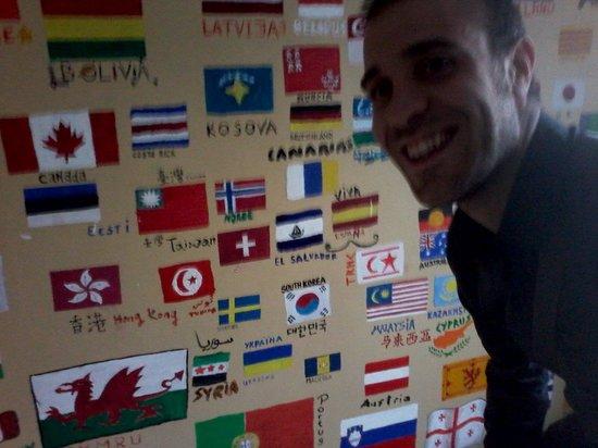 The Monk's Bunk Kaunas: Davide Luigi Paolo near the kitchen International flags decorated wall!