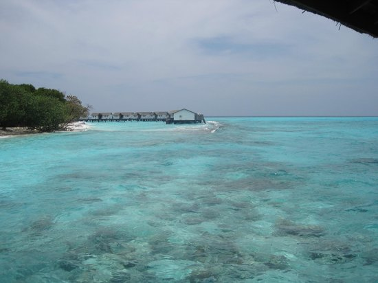 Reethi Beach Resort: View of water villas from Moodhu Restaurant