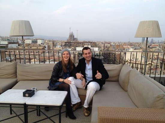 Majestic Hotel & Spa Barcelona : Us happy at the roof of the hotel - (And look what you see behind)