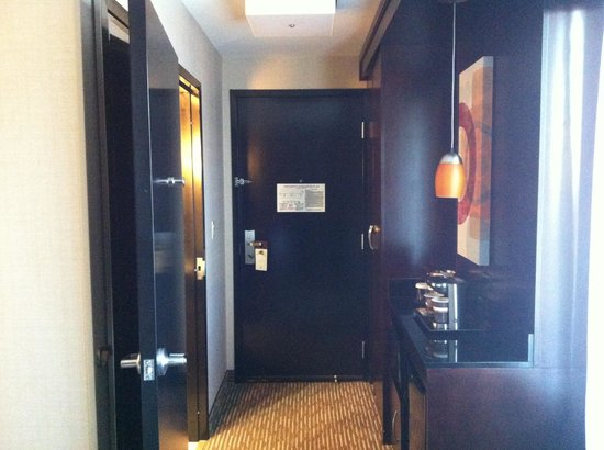 DoubleTree by Hilton Hotel Chattanooga Downtown: View of room entranceway; bathroom to left.  Fridge and microwave to right.