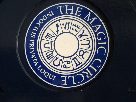 The Magic Circle: Magic Circle's front door sign