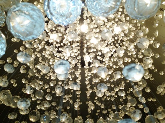 Latham, NY: Shine on. The gorgeous light fixtures hanging inside the salon.