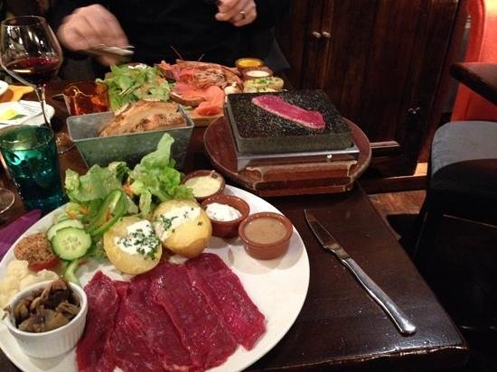 La Lycorne: my beef pierrade and my friends seafood platter in the backgrounf