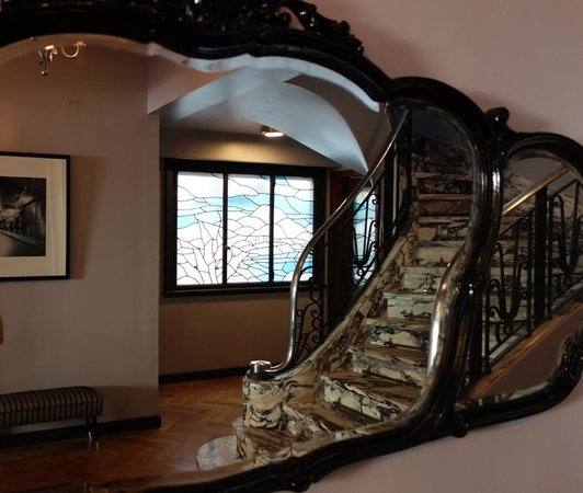 The 5th Floor: Lovely Art Deco staircase reflected in the entryway mirror.