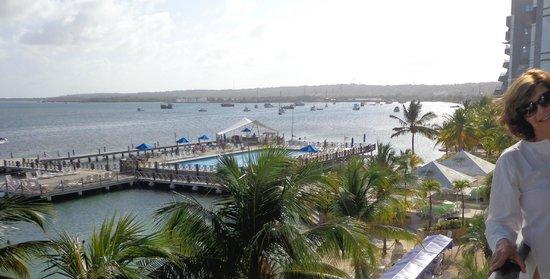 GHL Relax Hotel Sunrise : praia privada, pier e piscina vistos da sacada
